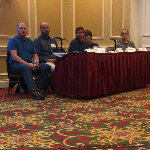 Panelists listen to audience questions.