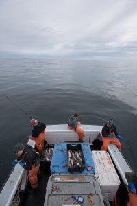 Fishermen aboard boat